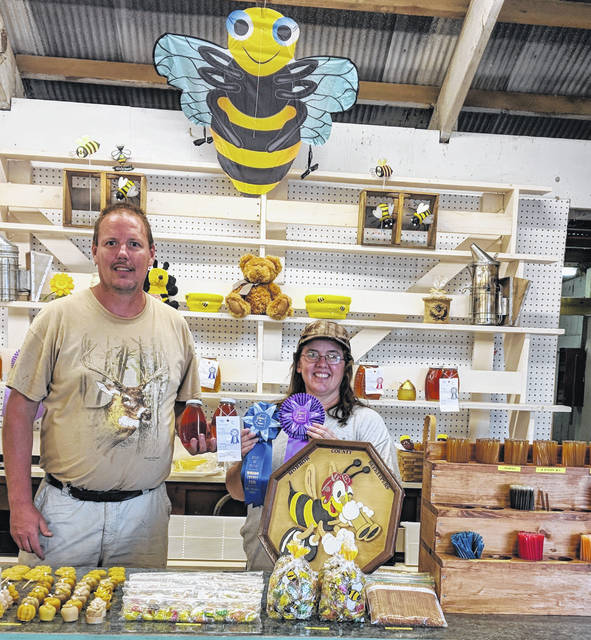 Bill and Angie Drake display some of their honey at the Morrow County Beekeepers booth at the fair. Angie's honey won Best of class and Best of Show.