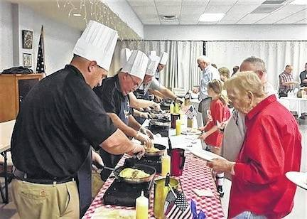 Guests line up to be served at last year's Celebrity Chef Omelette Breakfast.