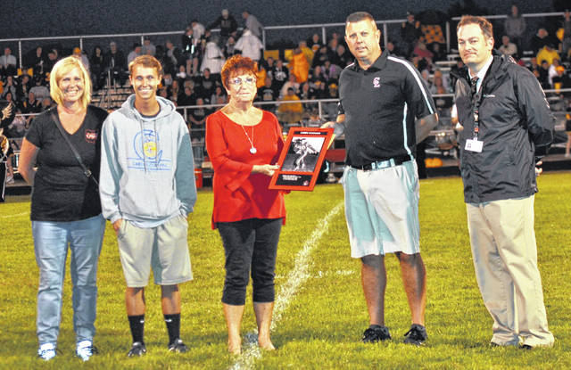 Accepting the posthumous award for Larry Coomer, who was inducted into the Cardington-Lincoln High School Athletic Hall of Fame are (l-r) niece Jill Pine, great nephew Aric Pine and sister Shirley Coomer Grosh. On the right are Cardington athletic director Tom Hack and superintendent Brian Petrie, who presented the award.