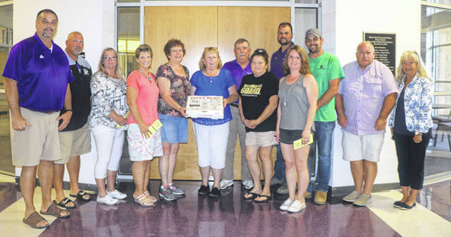 During Mount Gilead's pie auction, a group came together to purchase a Pizzaburg pizza for $1800 to raise money for the football and cheer teams.