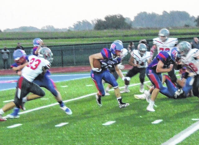 Jack Weaver darts past the Centerburg defense in Highland's 36-6 win over the Trojans.