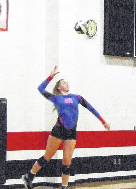 Raina Terry serves for Highland in their 3-0 win over Cardington Tuesday.