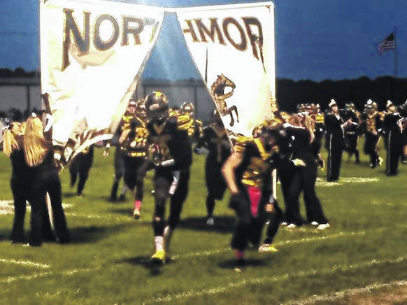 Northmor players run onto the field during Senior Night last Friday. The Golden Knights won their eighth game in a row topping Mount Gilead.