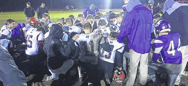 Cardington and Mount Gilead players and coaches gathered on the field for a post-game prayer. The Pirates won 30-16 in the season finale for both teams.