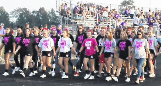 The Cardington FFA Chapter held its annual Fight for a Cure event uniting with powderpuff football to raise awareness. The chapter sold T-shirts and ribbons raising approximately $900 to donate to St. Jude's Cancer Research. The event took place before the football game when FFA and cancer survivors walked the lap around the Cardington-Lincoln High School track.