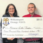 Theater group receives check from breakfast