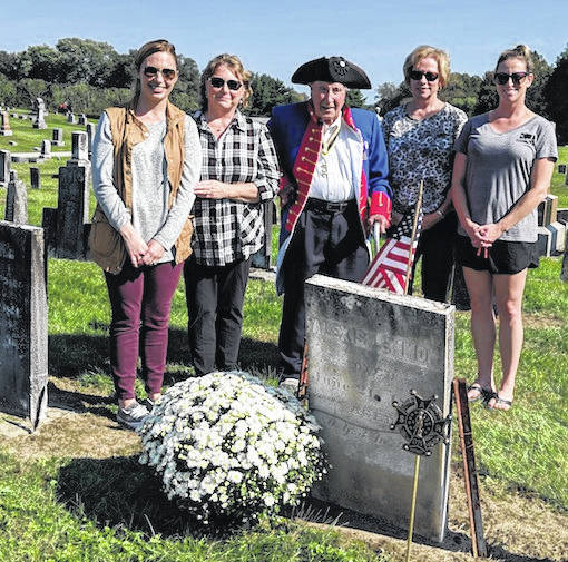 Descendants of Revolutionary War Veteran, Alexis Lemmon at his graveside at Shauck Cemetery with Pastor Patrick Kelly. From left are Kathleen Wood Luchsinger, Marcia Coe Wood, Pastor Patrick Kelly, Carol Coe Hartpence and Kelly Hartpence Beck.