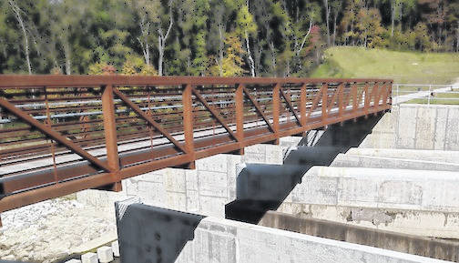 The new labyrinth spillway, topped by a walking bridge, is the first of its kind in the state.