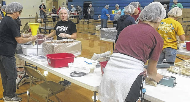 Highland FFA members package meals for families in Haiti.