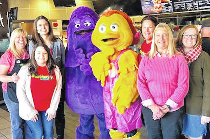 Members of the Cardington-Lincoln Middle School Staff who served the restaurant on McStaff Night. From left: Angela Adams, Emily Marconi, Anne Thomas, Grimace, Big Bird, iana McClure, Eileen Chappell, and Jenny Zierden, Middle School Principal.