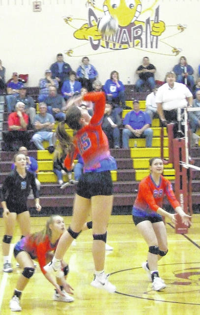 Highland's Abby Eusey attempts a kill in her team's three-set win over River Valley in the Division II district semifinals Wednesday night.