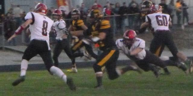 Cardington quarterback Nate Hickman turns up field against Northmor's defense Friday night. The freshman hit on 7-of-14 passes for 64 yards with one TD.