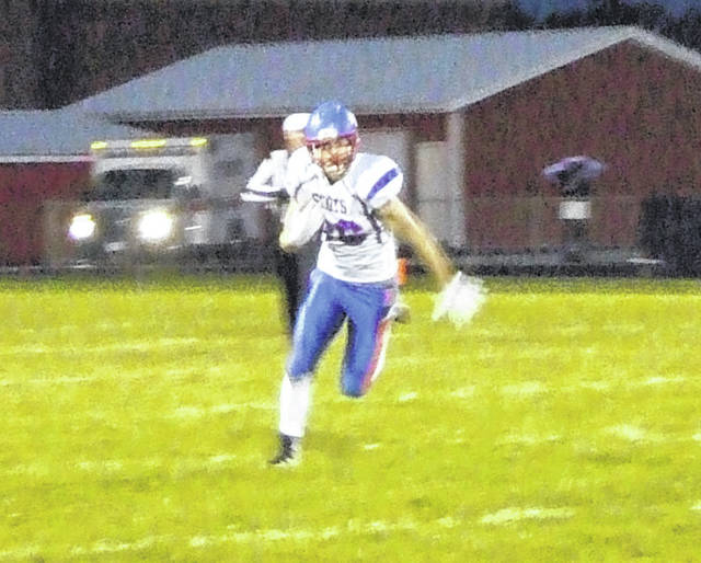 Highland's Jack Weaver heads to the outside for yards against Cardington on Friday.