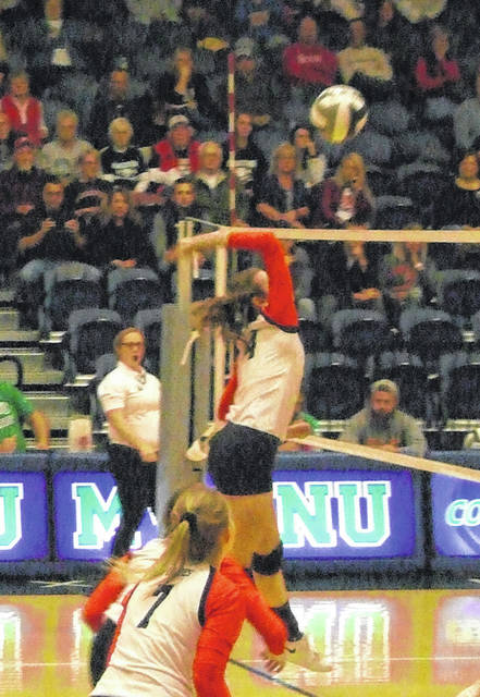 Katie Lester goes up for a kill attempt in Cardington's Thursday night district semifinal volleyball bout with Pleasant.