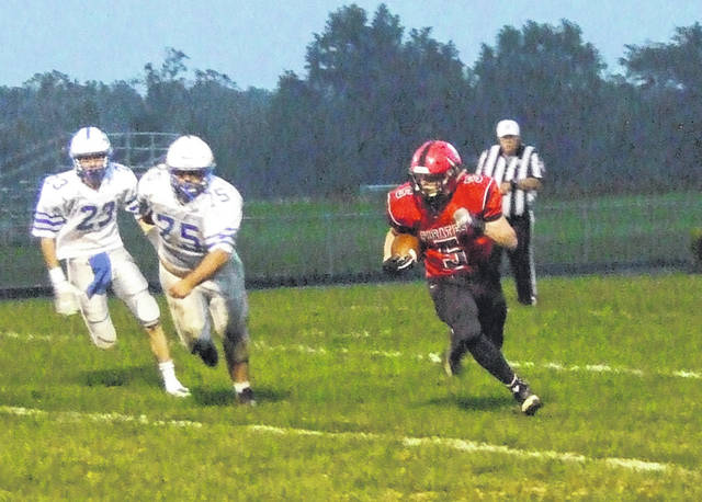 Cardington's Mason Goers looks to outrun members of the Danville defense on his way to a 150-yard performance Friday.