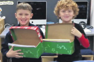 Students fill shoeboxes