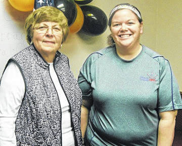 Rita Barton, president of the Gleaners Insurance Society, and Elizabeth Moore, chairman of the leadership team of Marion's Royal Kids Family.