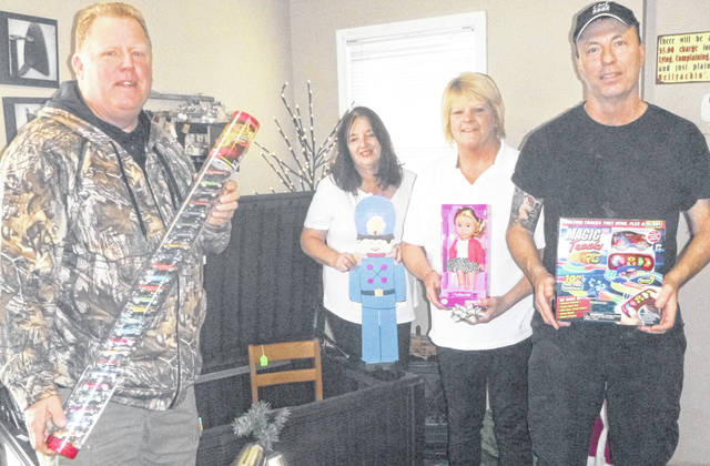 Edison Depot is holding a toy drive through Dec. 15. Shown are pastor Ed Colegrove of Edison Enterprise Baptist Church, owner Patty Collins, general manager Brenda Cain and kitchen manager Terry Currington.