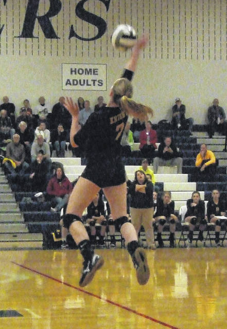 Northmor's Hanna Bentley reaches up for a hit in her team's regional semifinal match with Tinora Thursday night.