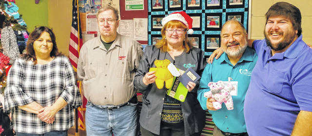 "Shown, from left, are Sandi Williamson, Aktion Club Advisor; Glenn LaVan, Club Treasurer; Julie Blankenship and Jeff Slider of Hospice, and Aktion Club President, Chad Wogan. The group, which is sponsored by Kiwanis, collected hats, gloves and scarves for the Clothes Closet and made grieving ""Care Bears"" for Hospice of Morrow County."