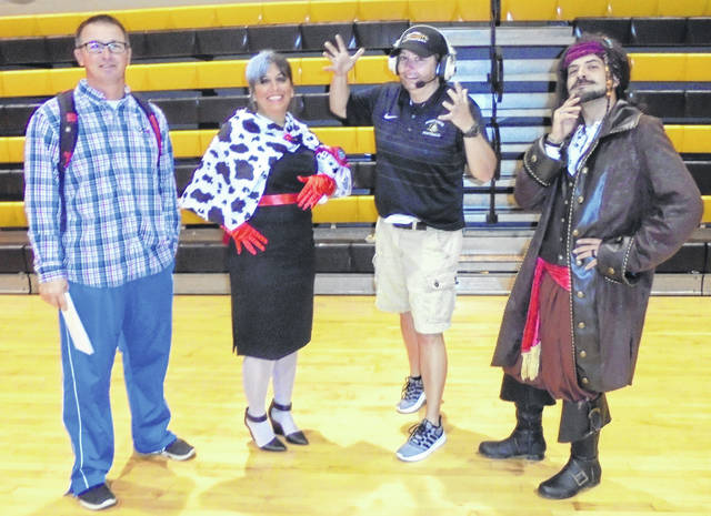 Teachers Buck Workman, Lisa Keddie, Carrie Johnson and Adam Frizzell all dressed up.