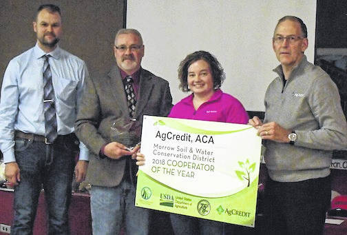 Ag Credit was the winner of the Cooperator of the Year Award when the Morrow County Soil and WaterConservation District held it annual banquet. Pictured, from left, are Mike Sayers, SWCD board member; Dan Barker, program administrator who presented the award to Andrea Bayles and Dan Ebert, from Ag Credit.