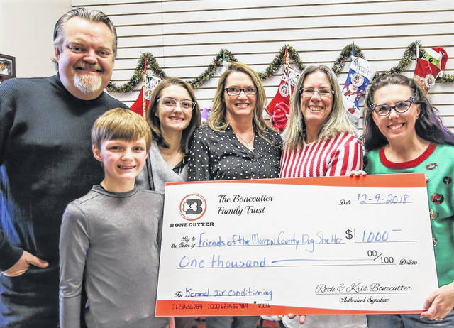 Making a check presentation, from left, are Rock Bonecutter, Brody Bonecutter, Maddie Bonecutter, Kris Bonecutter, Morrow County Dog Warden Sarina Atwell and Jennifer Tackett, President of Friends of the Morrow County Dog Shelter.