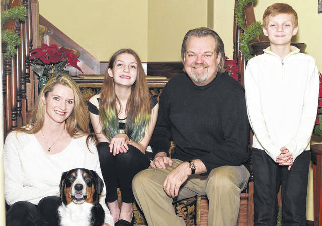 Rockwell and Krista Bonecutter, with their children, Maddie and Brody, and dog Toby.