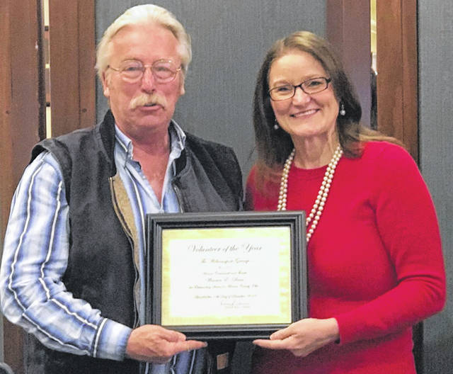 County Commissioner Warren Davis being awarded the Volunteer of the Year Award and presented by Master, Donna Carver. Davis was born in Morrow County. He moved away at the age of nine to Crawford County when his parents moved for jobs at North Electric and Iron Works.