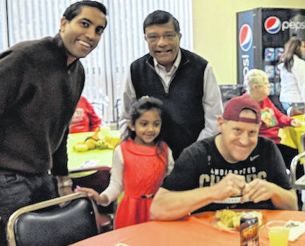 Shayer, Gia and Russ Shah serve dinner at Whetstone Industries with Justin Pryor.