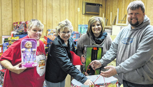Sorting the toys at Extreme Tec ATV are, from left: Karen Lashley, Brenda Harden, Shelley Planey and Extreme Tec ATV owner Jeff Barker. More than 200 families will receive toys from the Clearinghouse this Christmas.