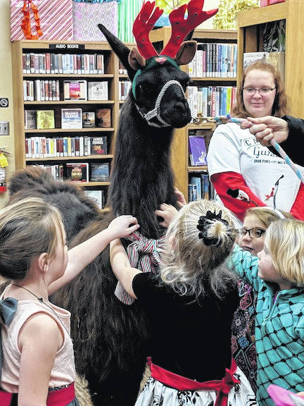 Having a llama in the library brought great joy to the children at Selover Library's open house.
