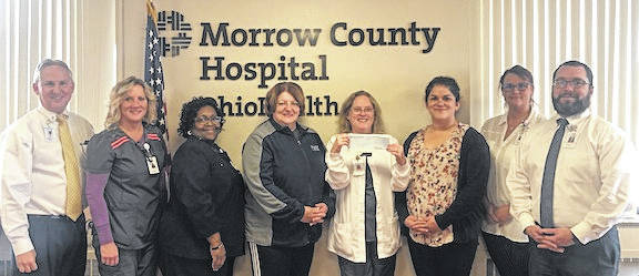 Shown, from left, are Michael Patterson Director of Operations, Missy Sauder, Respiratory Therapist; Le-Ann Harris Chief Nursing Officer; Jodi Hayes Executive, Director of United Way;Leslie Dye, Cardiopulmonary, Sleep Lab and Cardiopulmonary Rehab Manager; Ashley Glass Center Director; Tiffany Sayre, Administrative Assistant, and CJ Miller, Chief Executive Officer.
