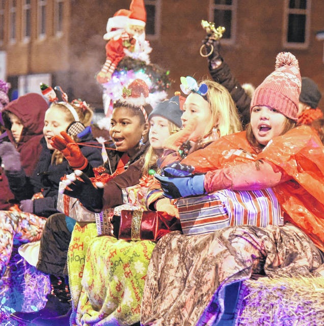 The downtown Christmas parade had more than 40 entries. A good crowd turned out in cold weather last Friday night. More photos online at morrowcountysentinel.com. Floats and caroling were part of Friday's downtown Mount Gilead Christmas Parade.