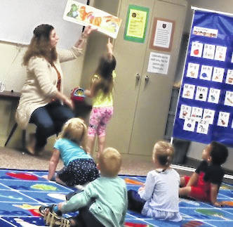 Hillary Scholz reads a dinosaur counting book to the children. The Cardington-Lincoln Public Library invites you to the 2018-2019 STEPS Story Time Program for children ages three to five. Younger siblings are also welcome to attend. Story Time is held every Tuesday from 10:45 to 11:45 a.m. through May 14, 2019. Each week's session will focus on a fun theme and will include stories, songs, action rhymes, and activities. Weekly themes will be dinosaurs, things that go, shapes, growing up and manners. Story Time is designed to build early literacy skills in young children while encouraging their natural curiosity and creativity and ultimately preparing them to be successful readers and lifelong learners. Parents and caregivers are encouraged to participate in the program with the children.