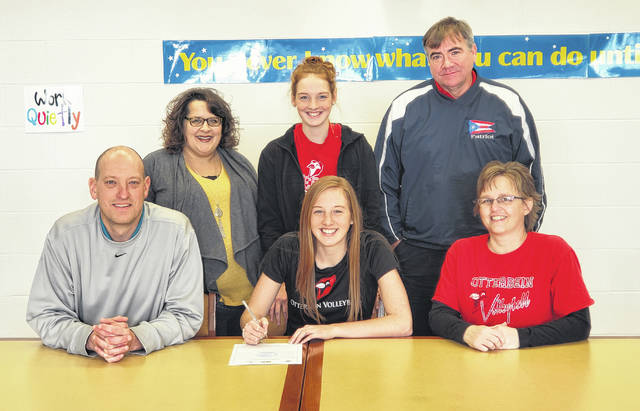 Anna Donner recently signed to play volleyball for Otterbein. Pictured are, back row (l-r): Northmor volleyball coach Kara Wright, sister Abby Donner and club volleyball coach Jeff Moore. Donner is in the center of the front row, flanked by parents John and Deb.