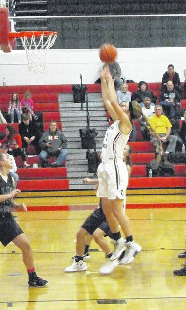 Casey Bertke goes up for two points in Cardington's win over East Knox in Friday night's girls' basketball game.