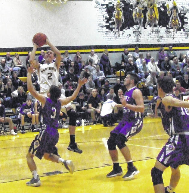 Northmor's Cole Dille goes up for a shot attempt against the Mount Gilead defense.