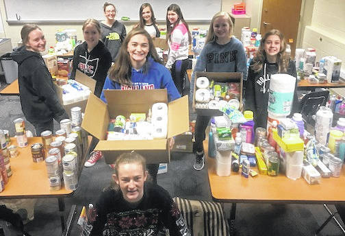 Highland Middle School student council sponsored a Giving Week Dec. 3-7. Students from all grade levels brought in over a combined 1,500 items. They will be donated to families in need within the community. Pictured with some of the items are 8th grade student council members, front: Allison McCafferty. Middle: Brooke Schott, Autumn Hefner, Juliette Laracuente, Alexis Eusey, Jada Peters Back: Kailyr Dickason, Ellie Pruett, Bailey Alexander.