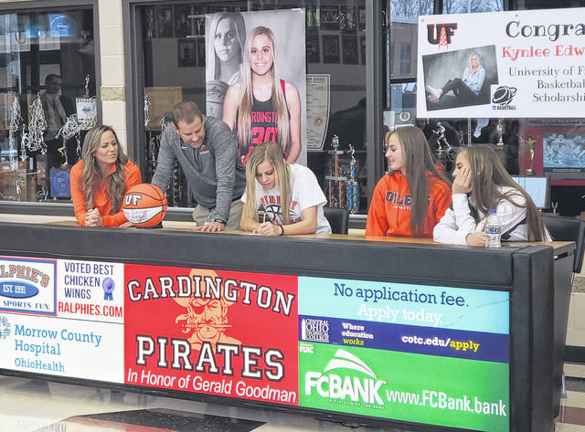 Cardington senior basketball player Kynlee Edwards signs her letter of intent to play for the University of Findlay. In the picture are (l-r): Charity Edwards (mother), Jamie Edwards (father and Cardington head girls' basketball coach), Edwards and Karsyn and Kambry Edwards (sisters).
