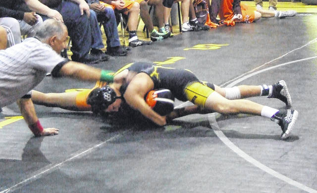 Northmor's Marcus Cortez pinned his Mansfield Senior opponent Wednesday and went 2-0 on the night to help his team claim a pair of dual wins.
