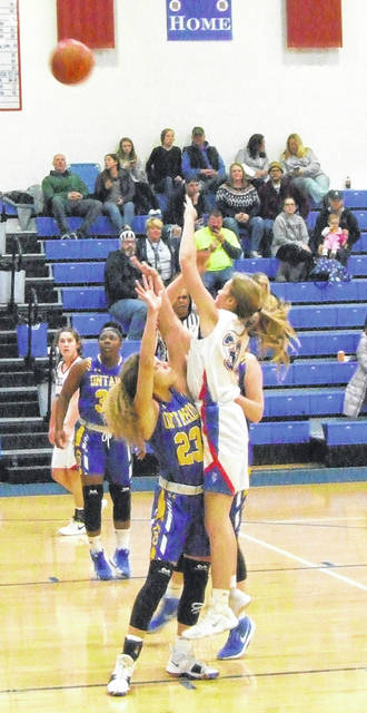 Highland's Raven Tilford puts up a shot over an Ontario defender in her team's Thursday night girls' basketball game.