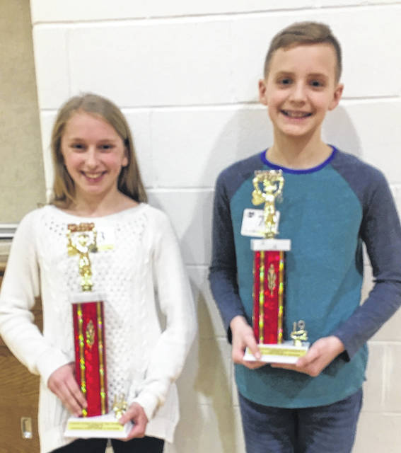 The champion and runner-up pictured are Camryn Miller from Highland Middle School and Grant Beard from Northmor. Shown in the top 12 are as follows: Row 1: Lorelai Myers, Camryn Miller, Keely Pearl, Grant Beard, Anique DiLorenzo, A.J. Brehm, Dane Creswell and Bryson Baker. Row 2: Jonah Allard, Robert Webster, Ciara Giamarco, and Ella Creswell.