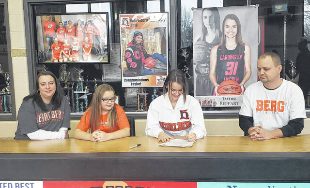 Cardington's Taylor Reppart signs to play basketball for Heidelberg University. With her in the picture are her parents, Jennifer (l) and Lyle, as well as her younger sister, McKale.