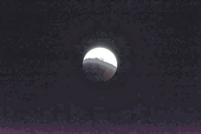 Sky gazers were treated to a rare lunar eclipse known as a super blood wolf moon on Sunday, Jan. 20, in which sunlight passing through Earth's atmosphere lit the celestial body in a dramatic fashion and turned it red.Watchers in North and South America, parts of Europe and western Africa, who were lucky enough to have clear skies, saw a total lunar eclipse. Jeff Hoffer, an amateur photographer from Bellville, captured this and other images.