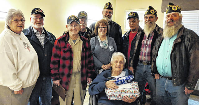 Veterans visiting at Woodside Village include, from left, Shirley and Don Broadwater, Carl Brady, John Shade, Jerry Jagger, Steve Dowalter, Mike McKinney and Bob George. In front is Woodside Activities Director, Susan Hedrick with veteran Joe Krejci.
