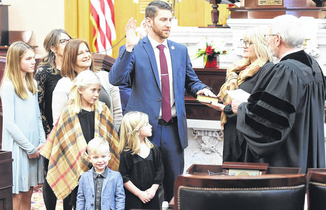 State Rep. Riordan McClain (R-Upper Sandusky) was sworn in Jan. 7 to his first full term as a member of the Ohio House of Representatives during yesterday's session. Here he is joined by his family.