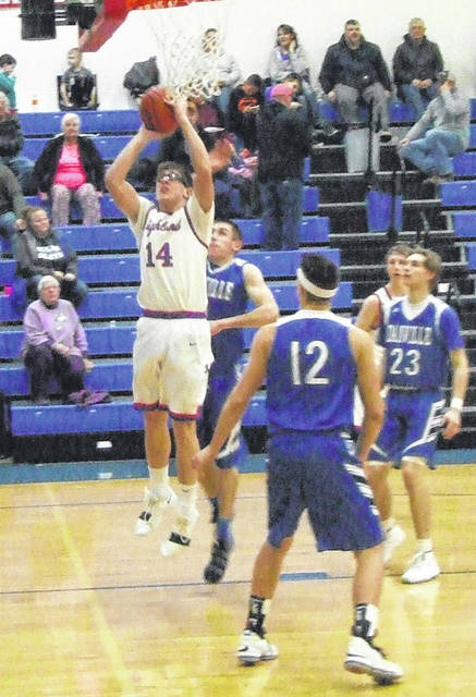 Highland's Chase Carpenter goes up for an easy lay-up in his team's Tuesday night win over Danville.