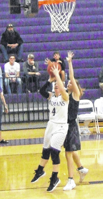 Dakota Shipman tries to put two points on the board for Mount Gilead in their Saturday afternoon game with East Knox.