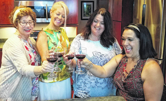 "From left are Susan Moreland, Mary Spence, Maureen Browning and Patti Goeppinger enjoying themselves in ""The Savannah Sipping Society."""